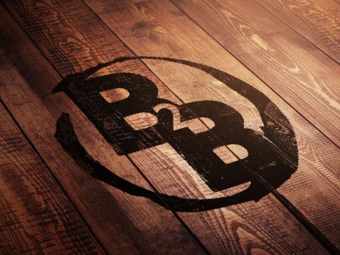 Broke To Bespoke Logo Embossed On Wood
